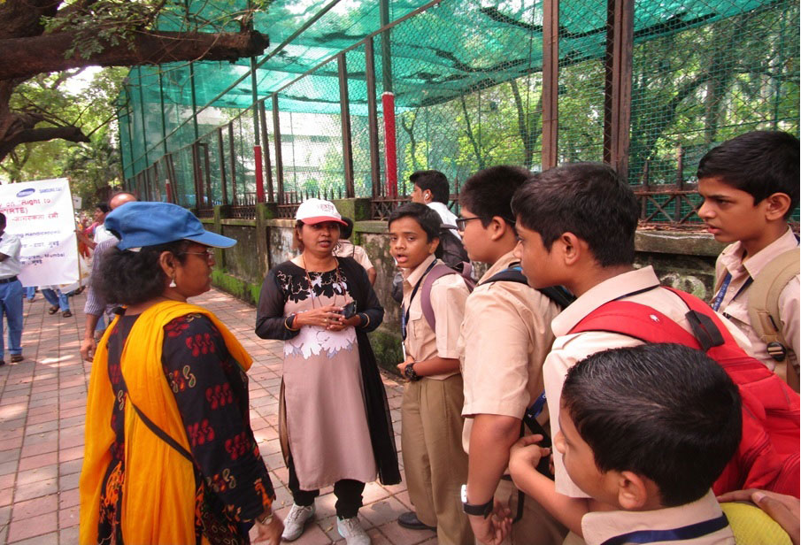 Teachers of Vikas Vidyalaya talking to students from other schools